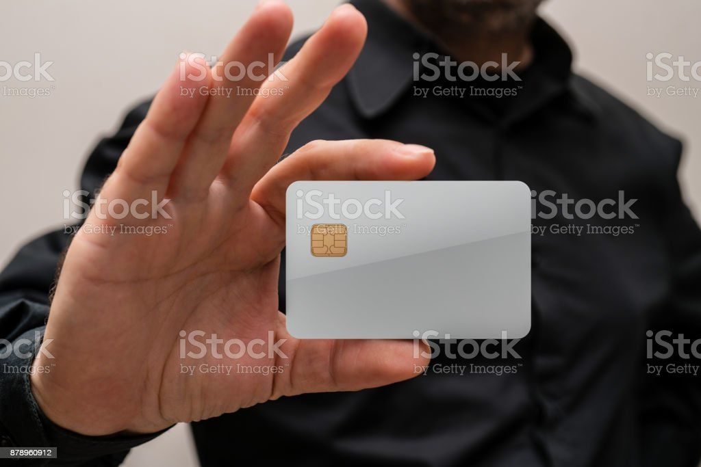 man holding a blank credit card in hands stock photo