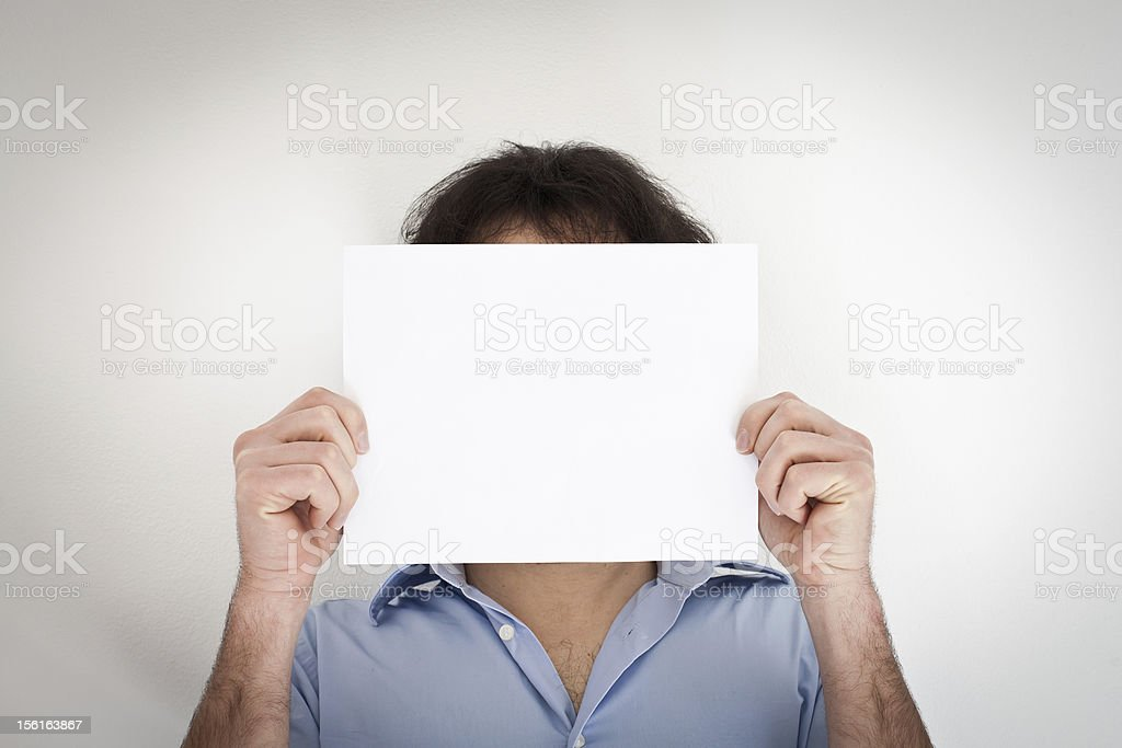 Man Holding a Blank Paper royalty-free stock photo
