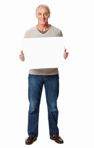 Full length portrait of a senior man holds up a blank sign. Vertical shot. Isolated on white.