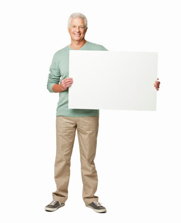 Elderly man holds up a blank sign with room for adding text. Vertical shot. Isolated on white.