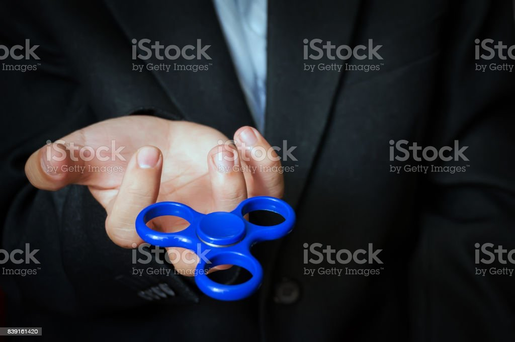 A man holding a blue spinner. stock photo