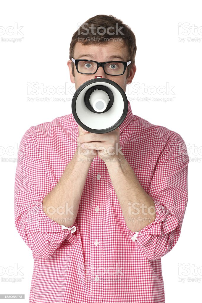 Man holding a bullhorn in front of his face royalty-free stock photo