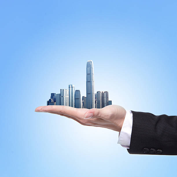 Man holding a city in hand stock photo
