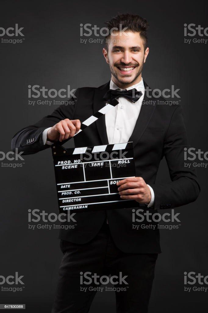 Homme tenant un Bardeau de bois - Photo