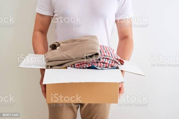 Man holding a clothes donate box donation concept picture id925211042?b=1&k=6&m=925211042&s=612x612&h= kda2jlsz86o 66af0qd6xiatfalvmxs3pggnhqnev4=