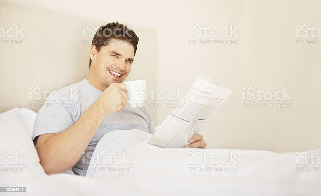 Man holding a coffee cup and newspaper royalty-free stock photo