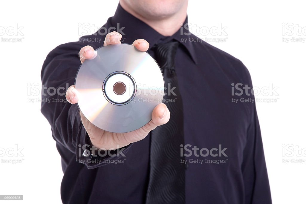 man holding a compact disc royalty-free stock photo