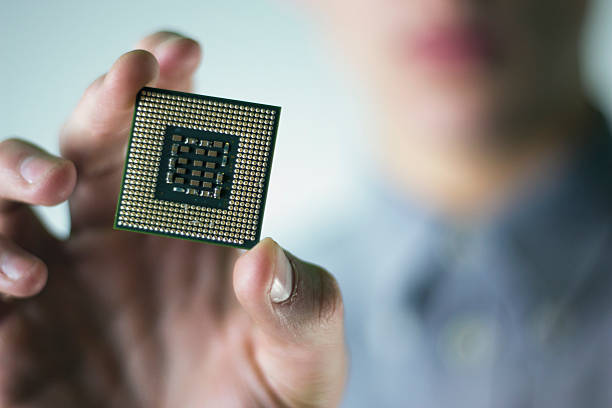 Man holding a computer chip stock photo
