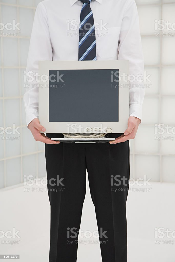 Man holding a computer monitor royalty-free stock photo