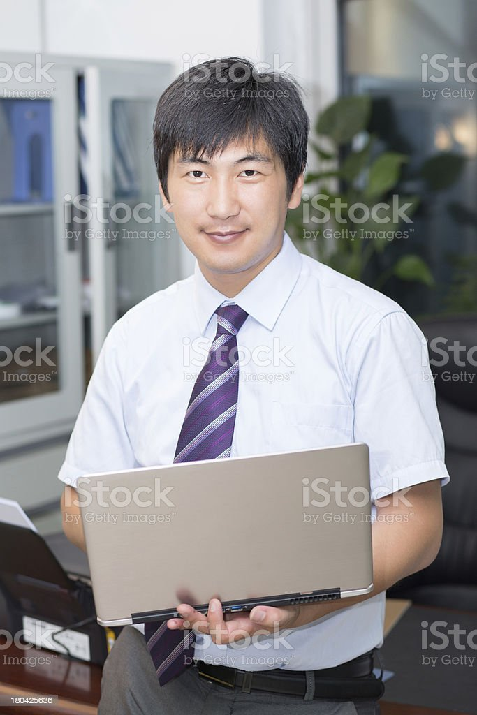 Man holding a computer royalty-free stock photo