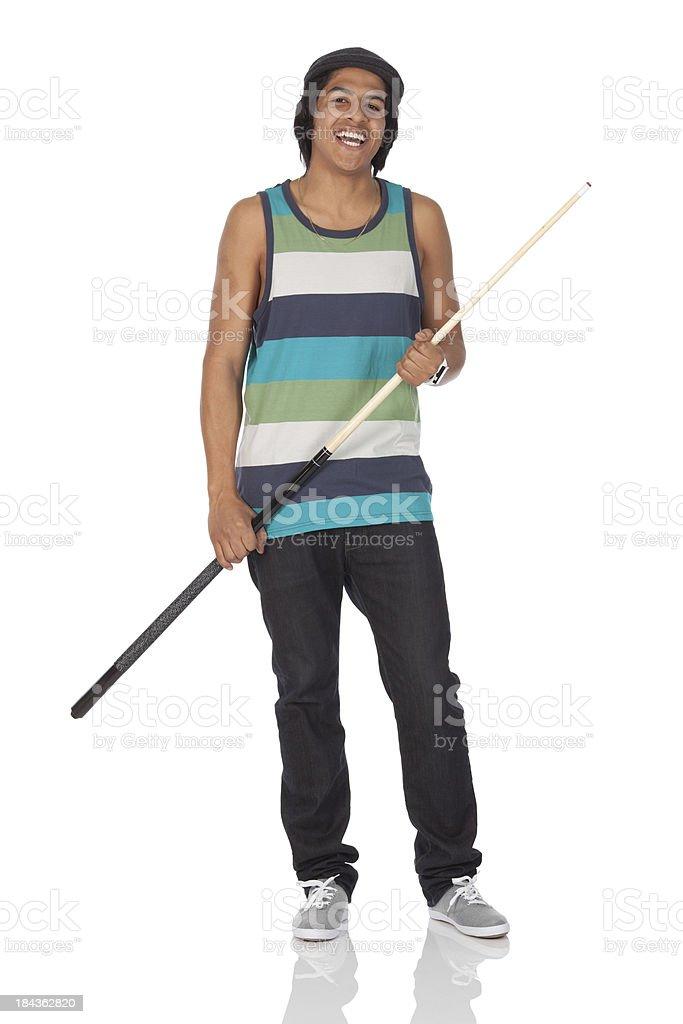 Man holding a cue stick stock photo