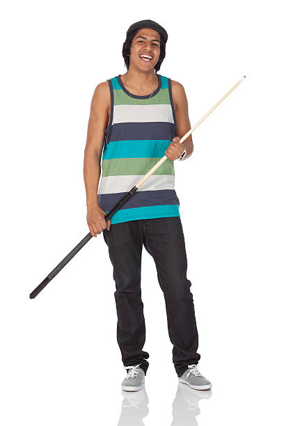 man holding a cue stick - pool cue stock photos and pictures