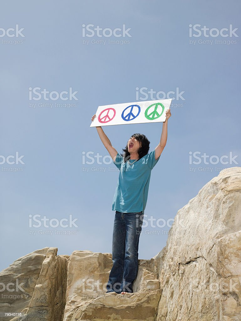 Man holding a end sign 免版稅 stock photo