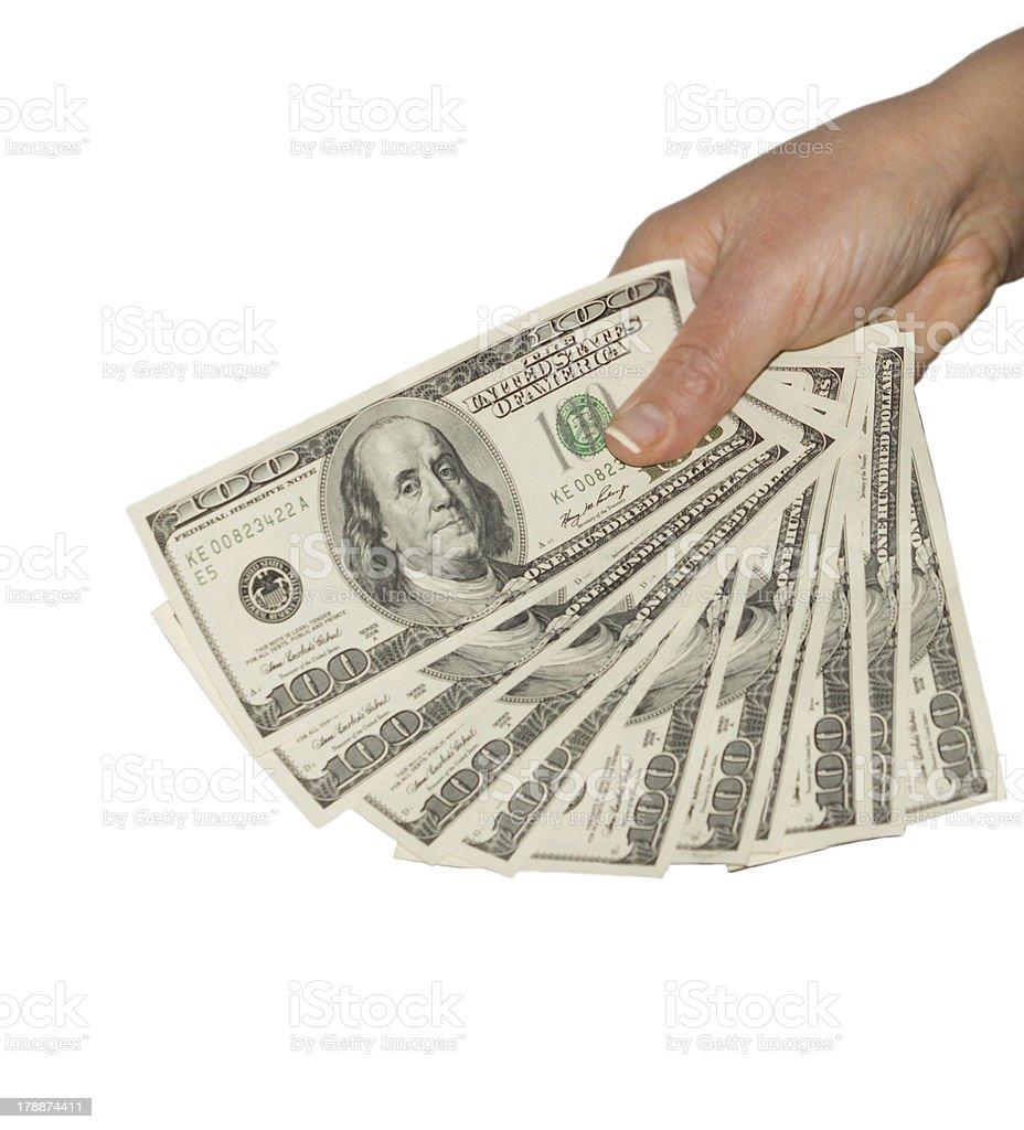 Man holding a fistful of 100 dollar bills stock photo