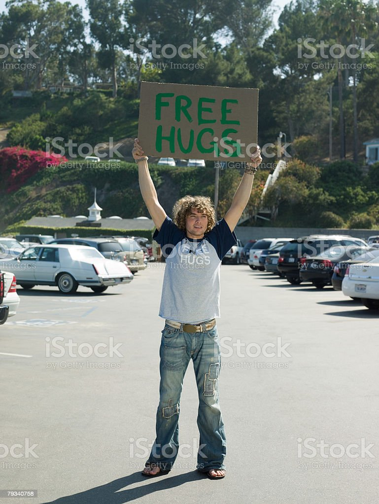 Man holding a free hug sign royalty-free stock photo