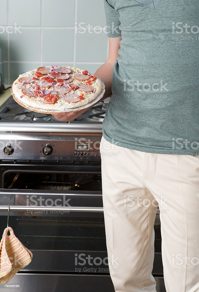 Man holding a frozen pizza royalty-free 스톡 사진