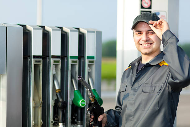 Man holding a fuel nozzle stock photo