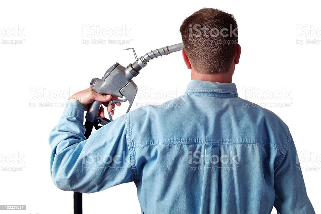Man Holding a Gas Pump To His Head royalty-free stock photo