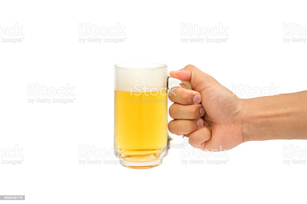 Man holding a glass of beer on a white background. stock photo