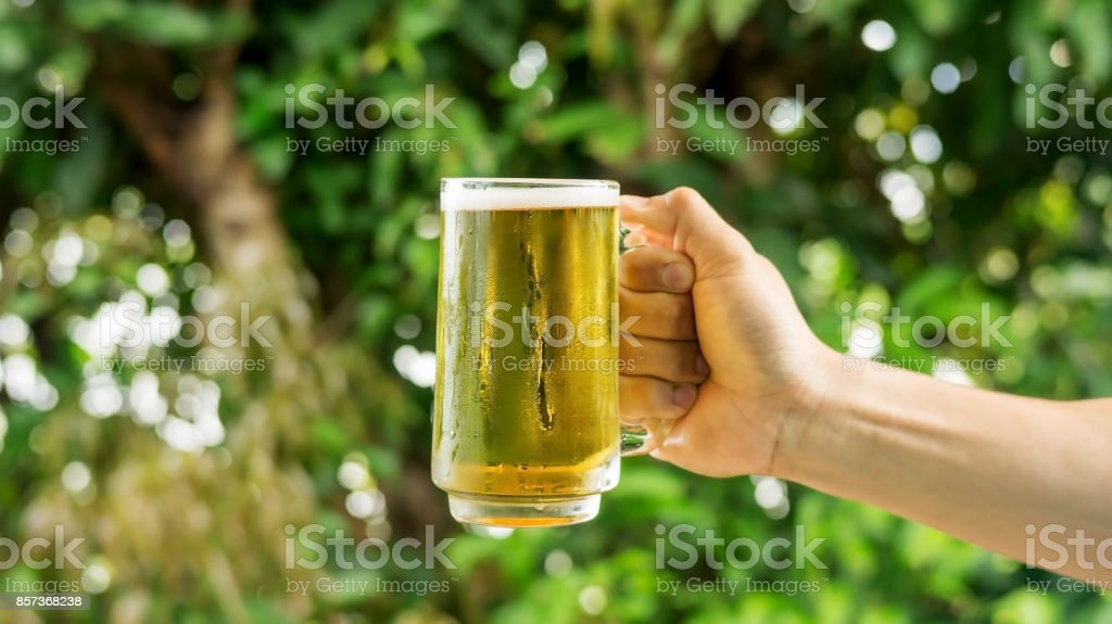 Man holding a glass of beer. stock photo
