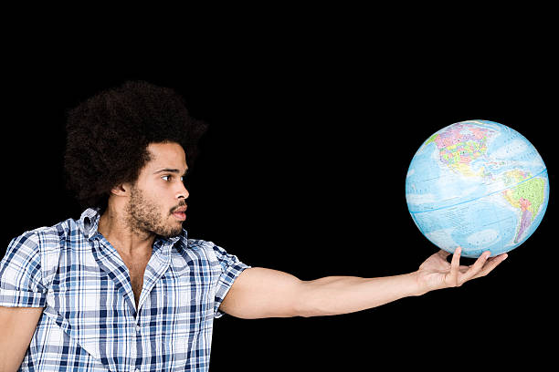 A man holding a globe stock photo