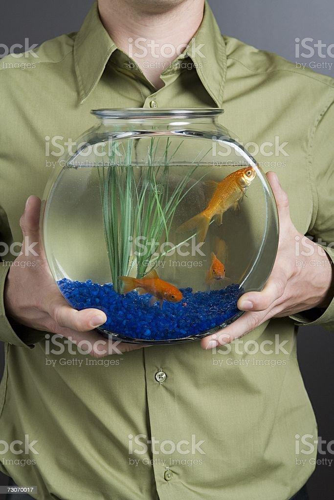 Man holding a goldfish bowl royalty-free stock photo