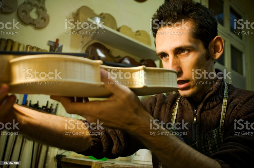 A man holding a guitar he designed stock photo
