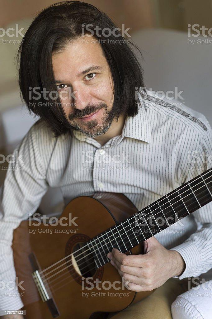 Man holding a guitar stock photo