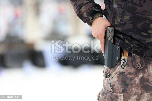 A man holding a gun in case