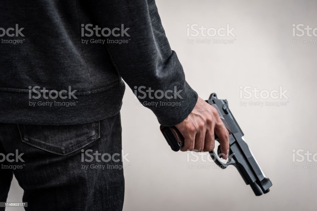 A man holding a gun in hand, the ship ready to shoot the man pointed...