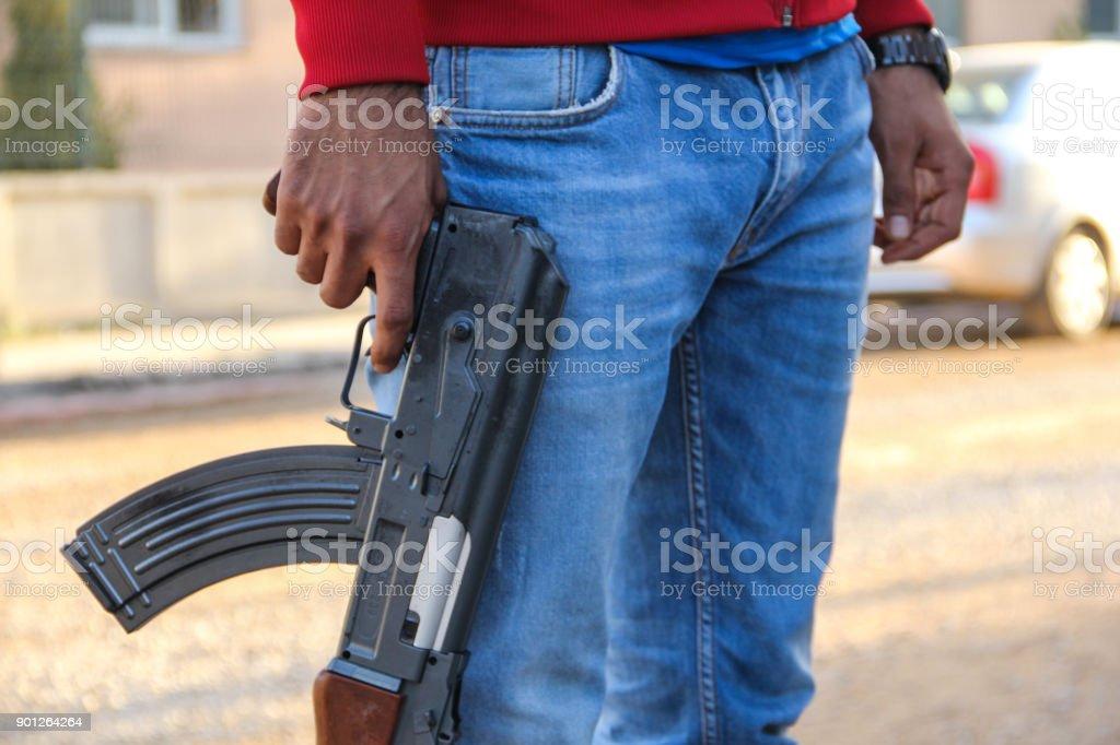 man holding a gun stock photo