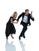 Man holding a hand gun and running with woman