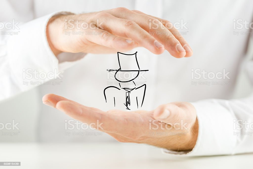 Man holding a hand-drawn figure stock photo