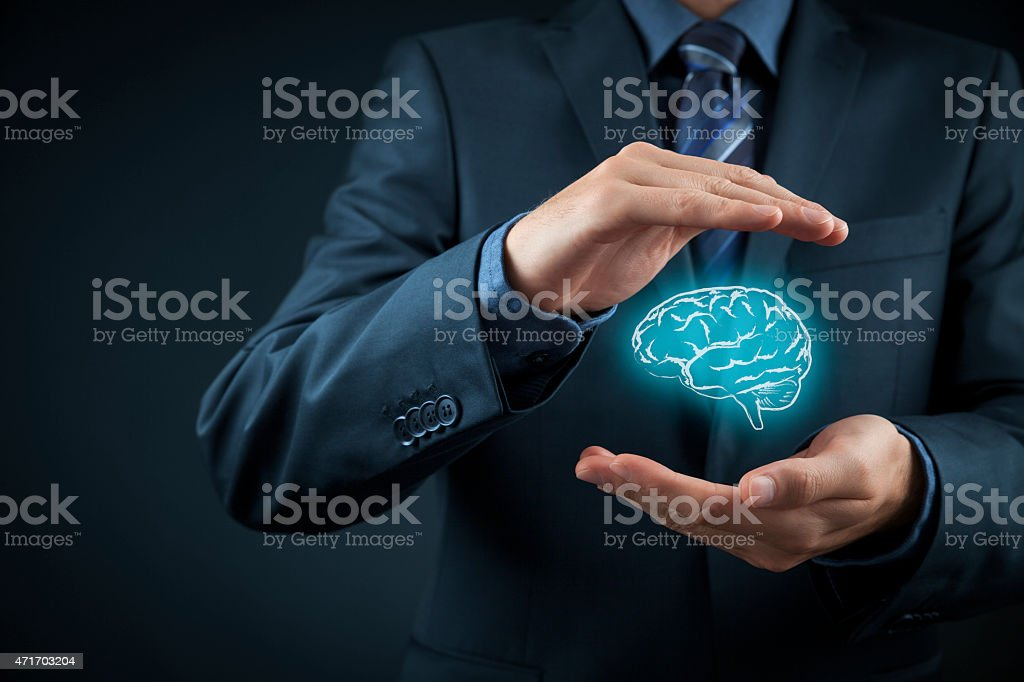 A man holding a hologram of a brain stock photo