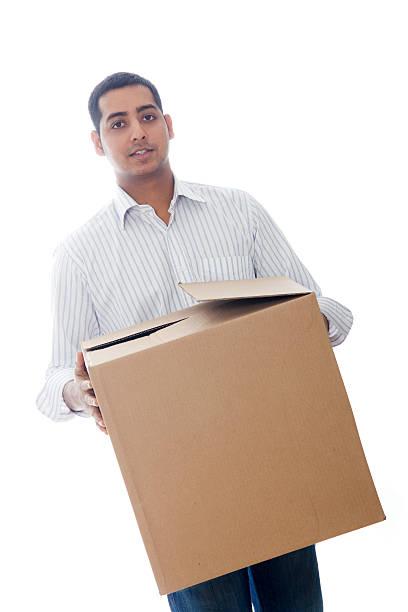 Man Holding a Large Moving Box stock photo