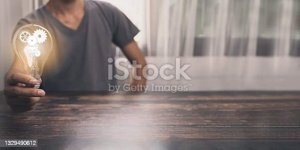 istock Man holding a light bulb, searching for ideas, new ideas, illustrations 1329490612