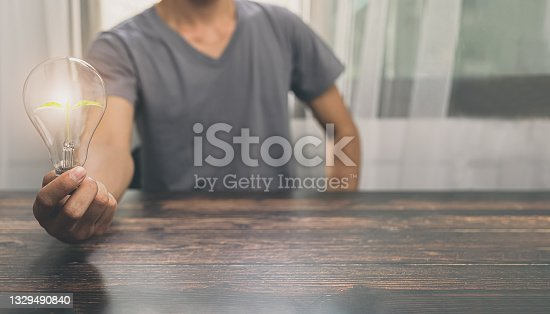 istock Man holding a light bulb, searching for ideas, new ideas, illustrations 1329490840