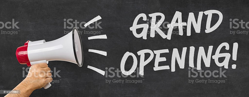 Man holding a megaphone - Grand opening stock photo
