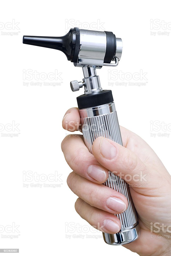 A man holding a otoscope against a white background stock photo