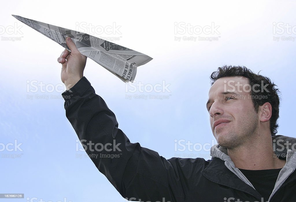 Man holding a paper airplane royalty-free stock photo