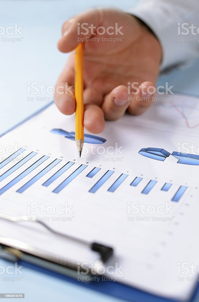 Man holding a pencil working on graph royalty-free stock photo