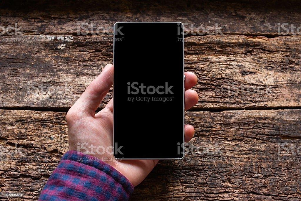 Mann mit einem Mobiltelefon in seiner hand mockup – Foto