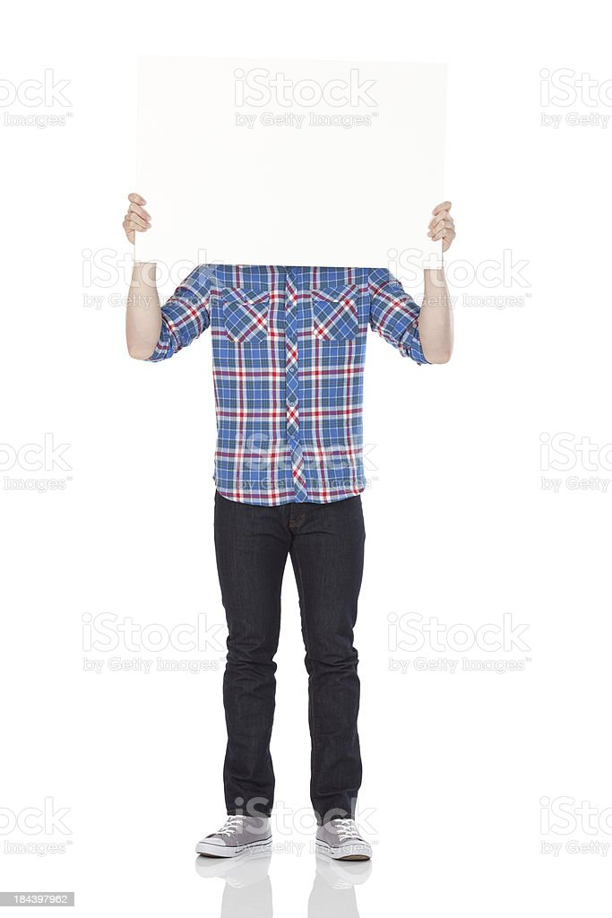 Man holding a placard in front of his face stock photo