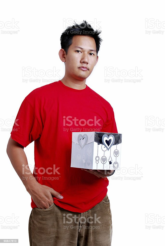 Man holding a present royalty-free stock photo