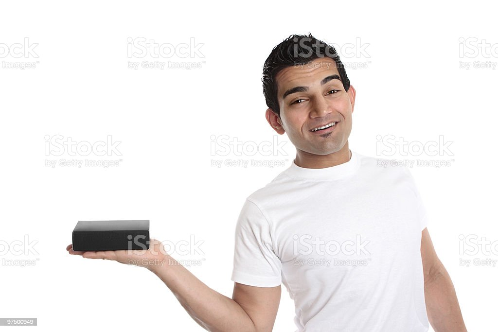 Man holding a product merchandise in one hand royalty-free stock photo