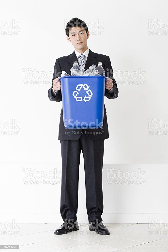 A man holding a recycling bin 免版稅 stock photo
