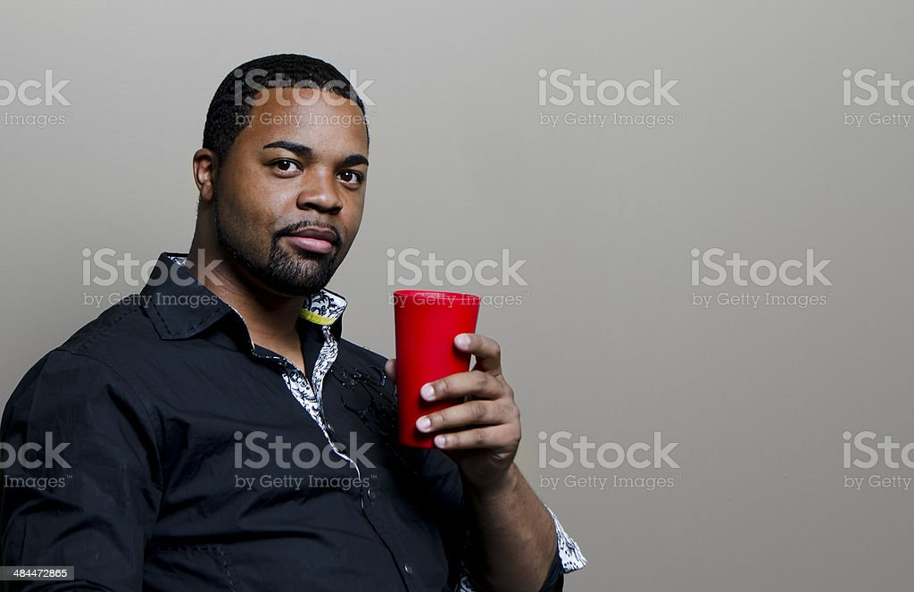 Man Holding a Red Cup stock photo