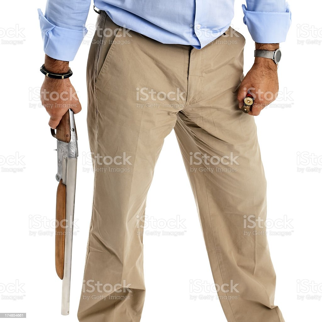 Man holding a riffle and cartridge royalty-free stock photo