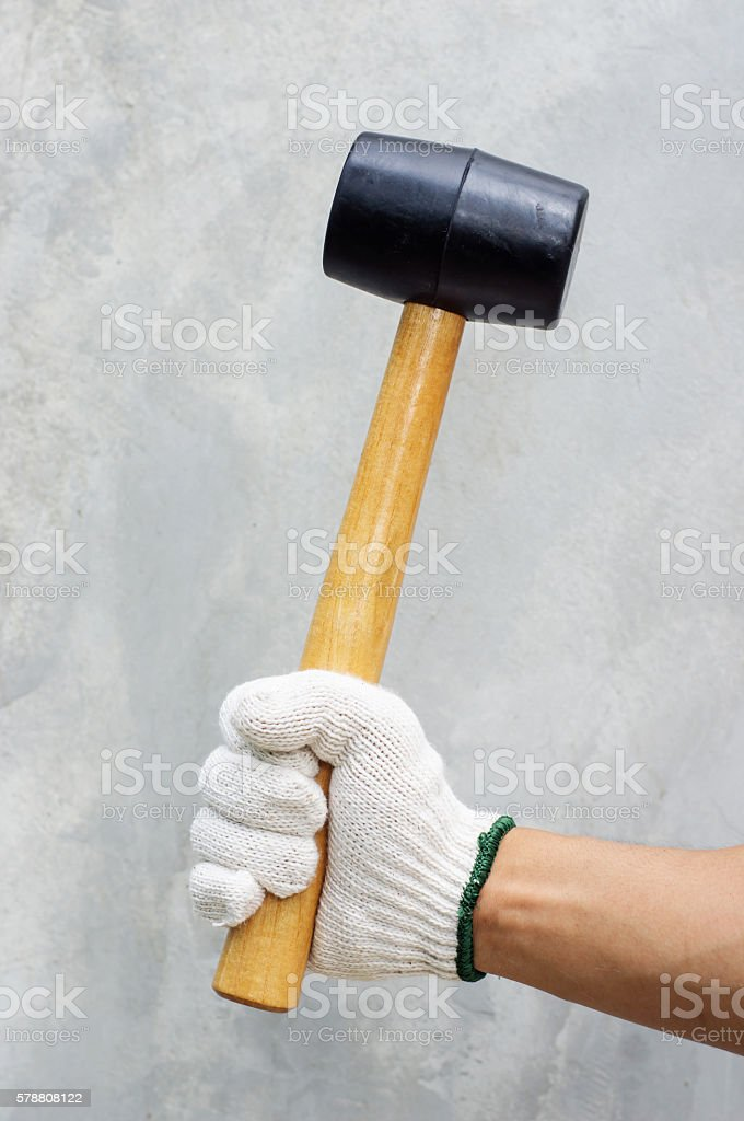Man holding a rubber hammer. stock photo