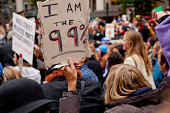 'Portland, Oregon, USA - October 6, 2011: A man holds a sign that says ''I am the 99%''.  Approximately 10,000 people joined the march for Occupy Portland on October 6, 2011 in Portland, Oregon.'